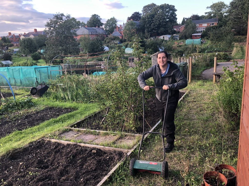 Lorrisa Roberts, ABF's Chief Officer mowing the allotment plot at Erddig Road.
